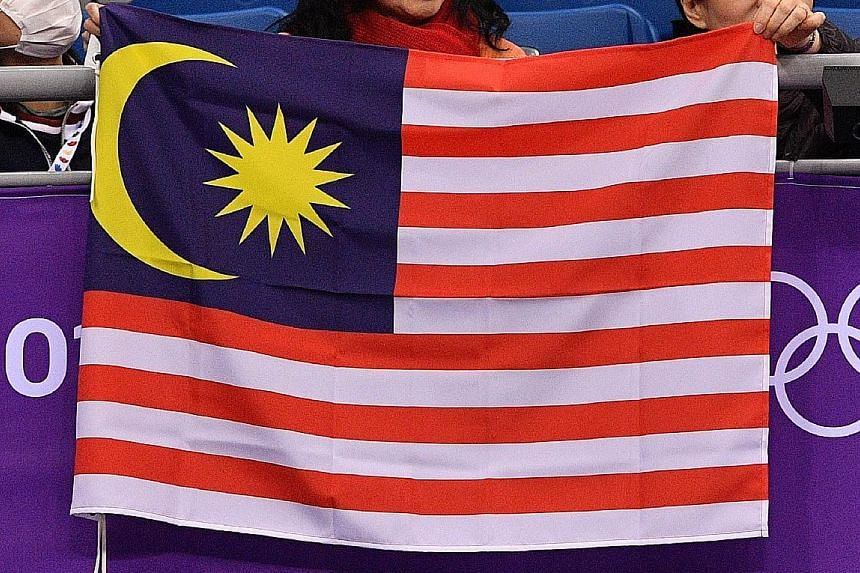 The Malaysian flag had been used at an outdoor party in Kansas last September by Malaysian engineer Munir Zanial who was celebrating Hari Raya and Merdeka Day - Malaysia's independence day - with friends and family. Some people who saw the flag, howe