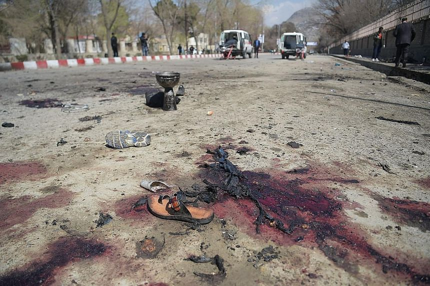 Victims' footwear left at the site of the bombing near the Kart-e Sakhi shrine in Kabul yesterday. The bomber had reportedly tried to reach the shrine but was prevented from getting closer by police checkpoints.