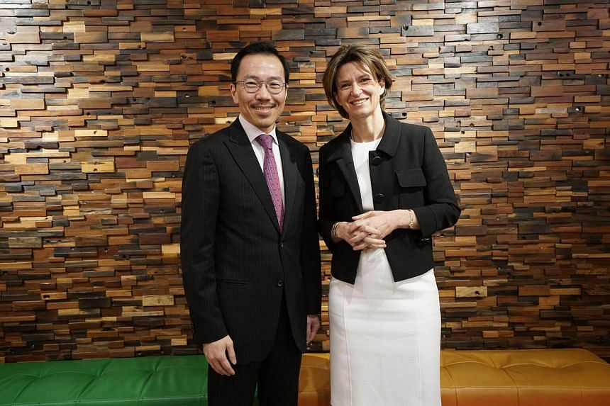 Chairman of the Singapore Economic Development Board Beh Swan Gin and Engie CEO Isabelle Kocher.