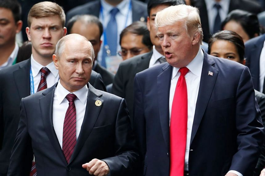Putin (left) and Trump at an Apec meeting in Vietnam in November 2017.