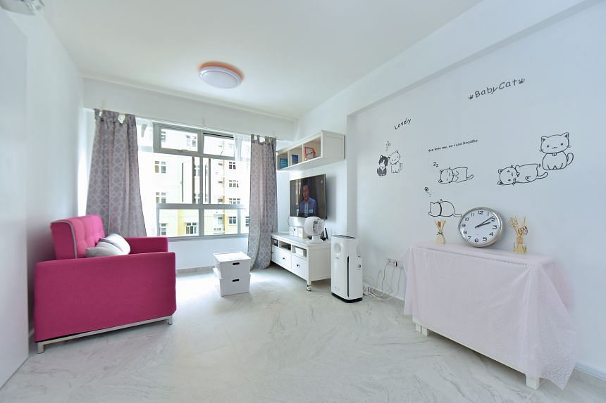 Her pink sofa, which also doubles up as a bed, adds colour to Ms Wong's home. PHOTO: LIM SIN THAI