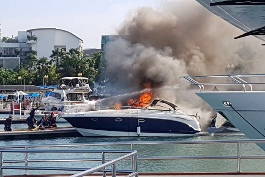 A photo taken by a passer-by shows the yacht engulfed in flames while berthed at One Degree 15 Marina Club.