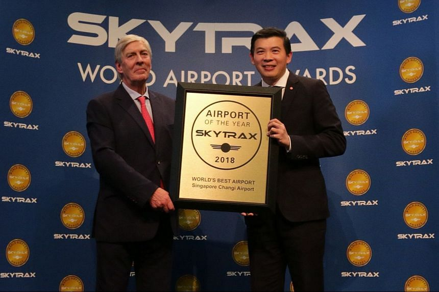 Mr Lee Seow Hiang (right), CEO of Changi Airport Group, receiving the Skytrax World's Best Airport Award from Mr Edward Plaisted, CEO of Skytrax.