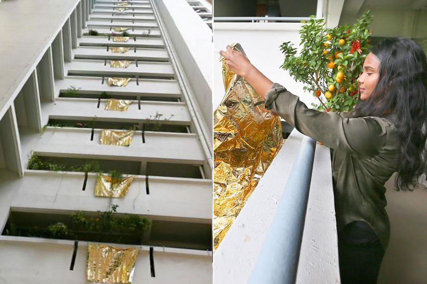 The 24 sheets of gold - one hung from every floor, except the ground - had been put up on March 18, 2018, by freelance artist Priyageetha Dia.