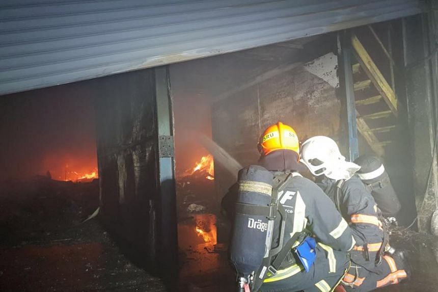 The SCDF deployed 22 firefighting appliances and vehicles and about 70 personnel to combat the fire. PHOTO: SCDF/FACEBOOK