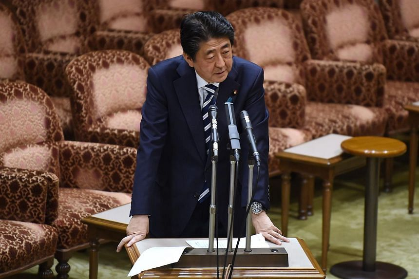 Japan's Prime Minister Shinzo Abe answers questions during a budget committee session of the upper house in Tokyo on March 19, 2018.