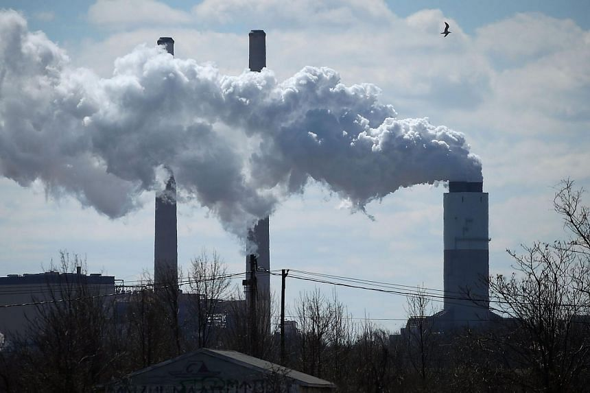 Emissions spew from a chimney of a coal-fired power plant in Baltimore, Maryland, on March 9, 2018.