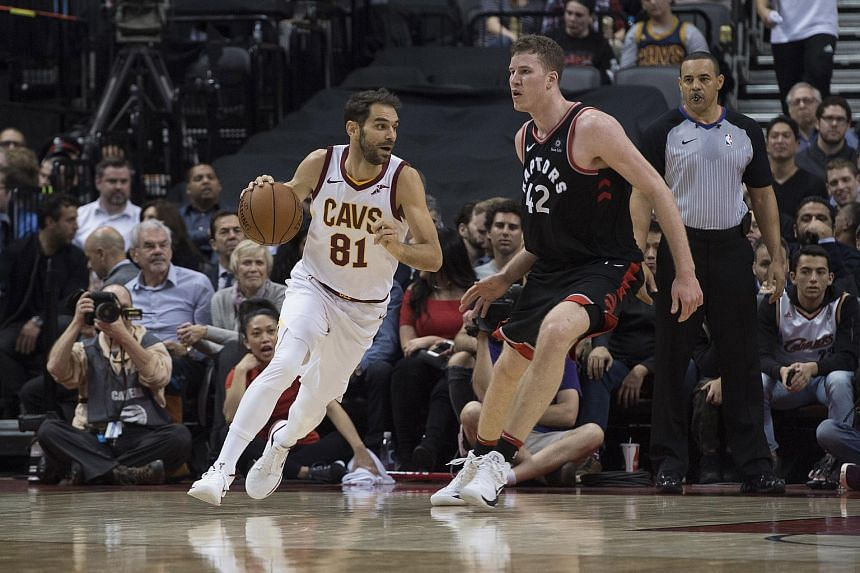 Cleveland Cavaliers guard Jose Calderon (81) controls the ball as Toronto Raptors center Jakob Poeltl (42) defends in the fourth quarter at Air Canada Centre.