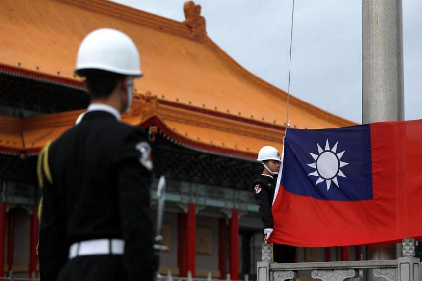 Military honour guards attend a flag-raising ceremony at the Chiang Kai-shek Memorial Hall in Taipei, Taiwan, on March 16, 2018.