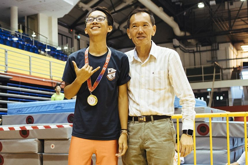 Louis Ang, 16, the B Division individual champion from Whitley Secondary, with East Spring Secondary principal Teoh Teik Hoe.