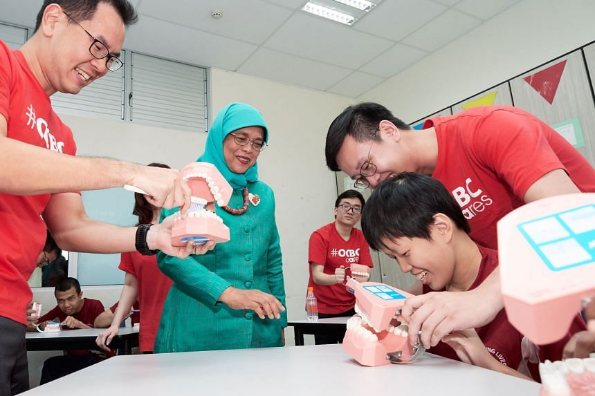 """President Halimah Yacob at the opening of the Developmental Disabilities Medical Clinic at Kembangan-Chai Chee Community Hub yesterday. She called it a """"safe environment"""" for the intellectually disabled to get treatment. The clinic offers specialised"""