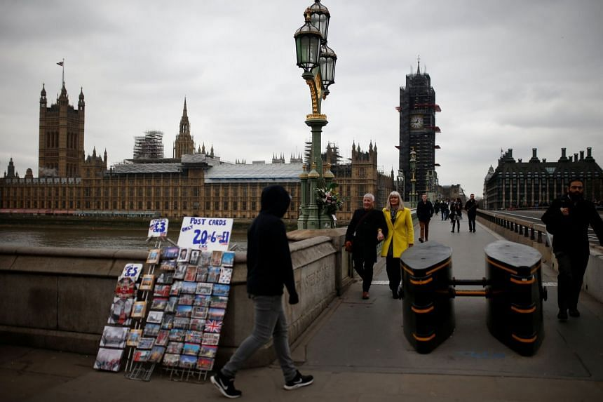 Messages and flowers left on Westminster Bridge by members of the public to pay their respects on the anniversary of the terror attack in London on March 22, 2018.