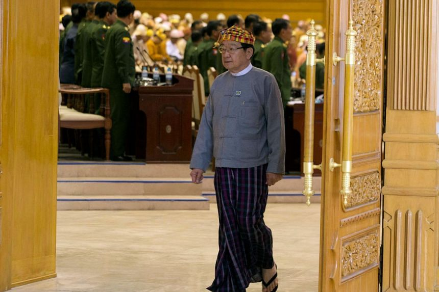 U T Khun Myat leaves the parliament after he got elected as speaker of the Lower House of Parliament in Naypyitaw on March 22, 2018.