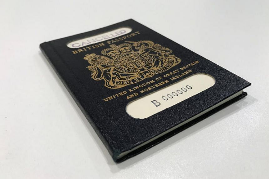 The original blue British passport, which was subsequently replaced by the current burgundy document.