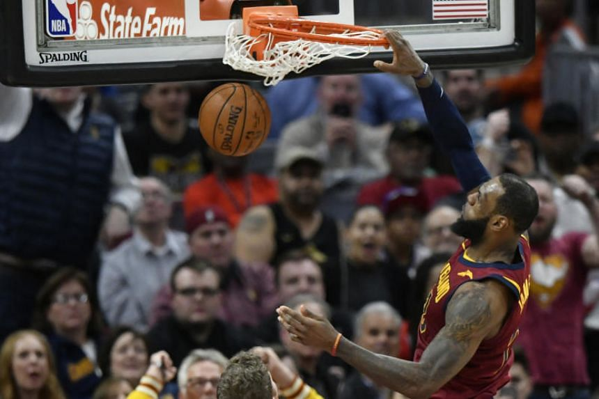 Cleveland Cavaliers forward LeBron James dunks in the fourth quarter against the Toronto Raptors at Quicken Loans Arena.
