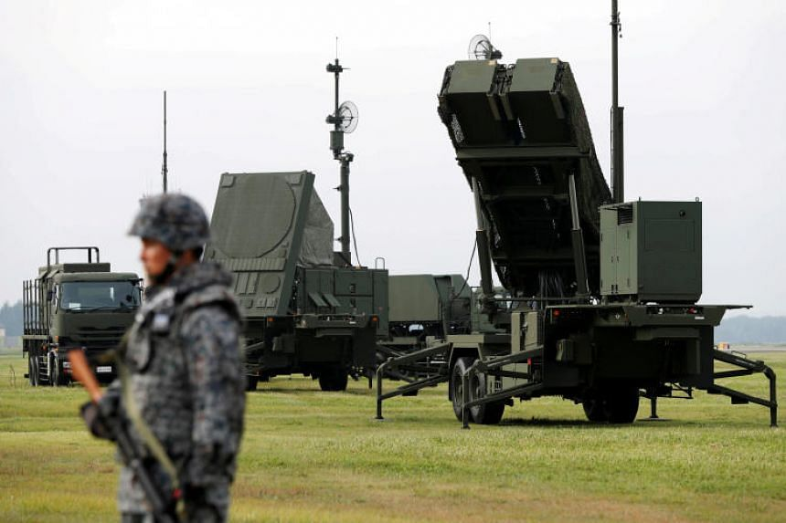 A Japan Self-Defense Forces soldier takes part in a drill to mobilise their Patriot Advanced Capability-3 missile unit, in response to a missile launch by North Korea, at the US Air Force's Yokota Air Base in Fussa, Japan, on Aug 29, 2017.