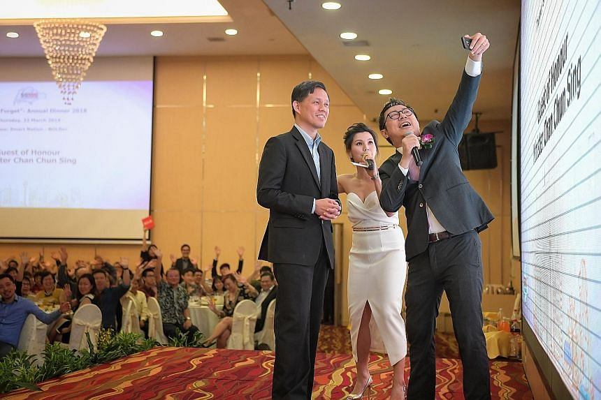 Minister in the Prime Minister's Office Chan Chun Sing taking a wefie with emcees Charissa Seet and Eugene Seah at the SG100 Foundation's dinner at the Singapore Expo last night.