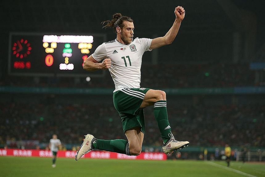 Gareth Bale celebrating one of his three goals in the 6-0 win against China as he overtakes Ian Rush (28) as Wales' all-time top scorer with 29 goals. His appearance in Nanning also helped Wales avoid losing £100,000 (S$186,100) of their £1 million
