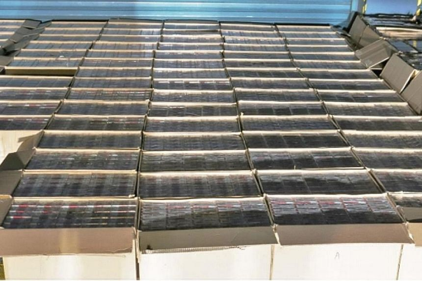 Singapore Customs officers conducted a check on a white truck during an operation in the vicinity of Jurong Port and uncovered a total of 10,500 cartons of contraband cigarettes (above).