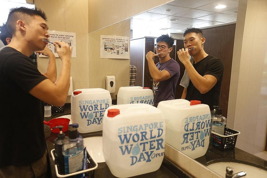 Students - and staff - of Ridge View Residential College brushed their teeth (above), washed their hands and bathed using jerry cans and buckets (right) yesterday as part of NUS' save-water campaign.