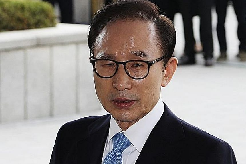 Mr Lee Myung Bak, who denies most of the allegations, is suspected of taking 11 billion won (S$13.5 million) in bribes.