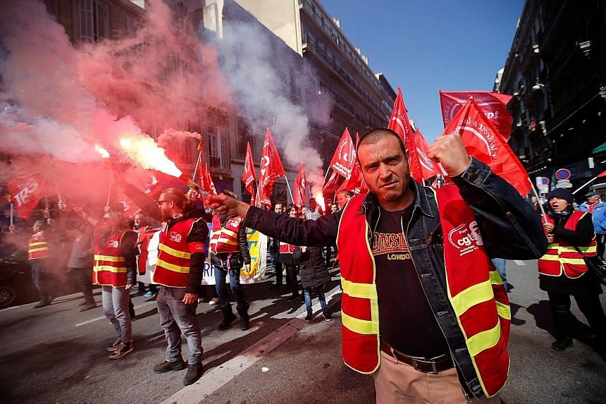 Protesters in Marseille yesterday. Fast trains, inter-city trains and flights to and from Paris airports were cancelled because of the strikes, while about 13 per cent of teachers walked off the job, causing many primary schools to close.