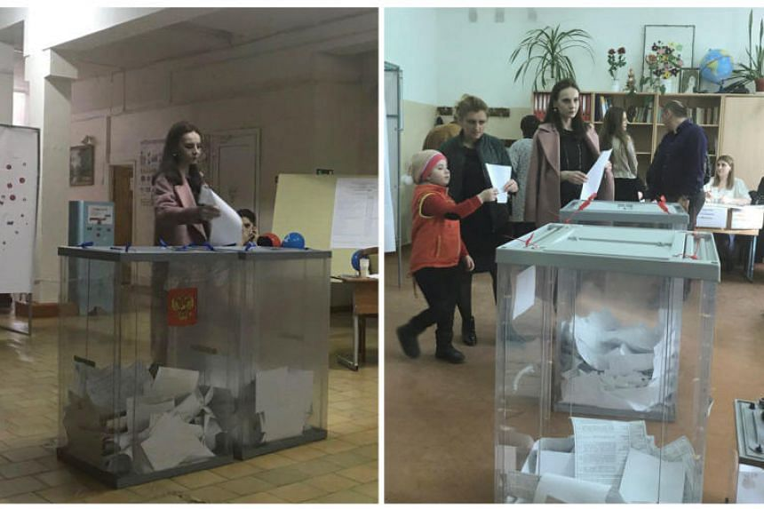 A combination picture shows a voter, casting a ballot at a polling station number 216 (left) and walking with a ballot at a polling station number 217, during the presidential election in Ust-Djeguta, Russia on March 18, 2018.