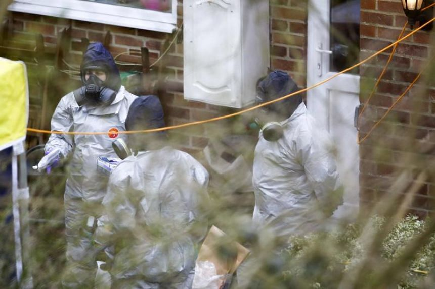 Investigators work in the garden of Sergei Skripal's house in Salisbury, southern England, on March 22, 2018, as investigations and operations continue.