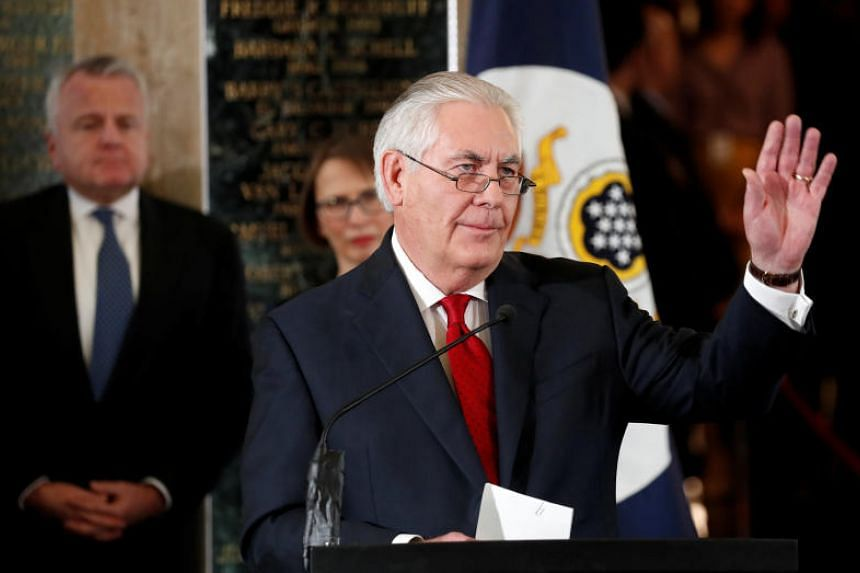 Outgoing US Secretary of State Rex Tillerson waves to employees upon his departure from the State Department in Washington, US on March 22, 2018.