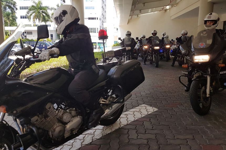 Land Transport Authority and covert Traffic Police officers leaving the Traffic Police headquarters in Ubi for their joint operation on March 23, 2018.