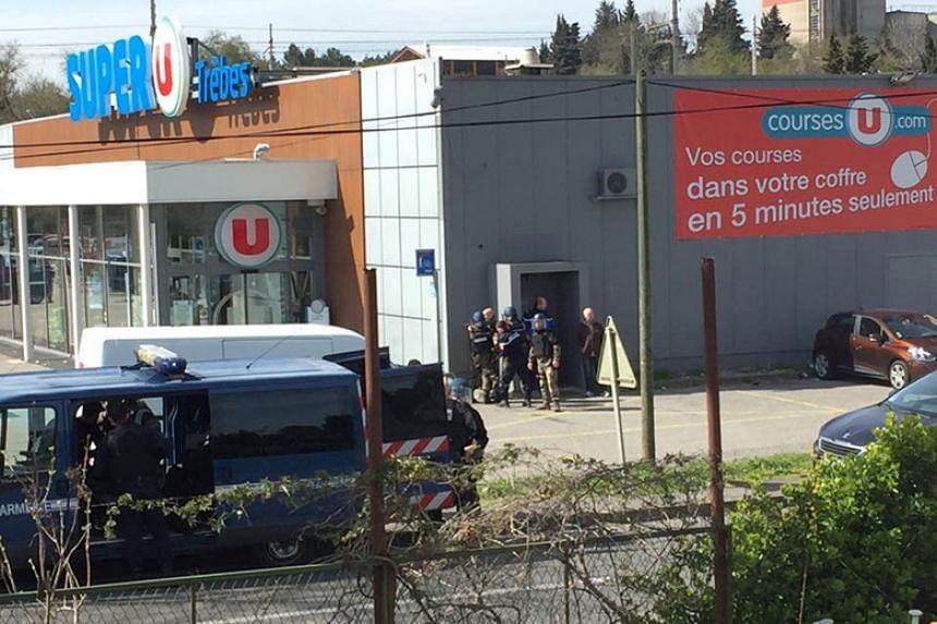 Police are seen at the scene of a hostage situation in a supermarket in Trebes, France, on March 23, 2018.