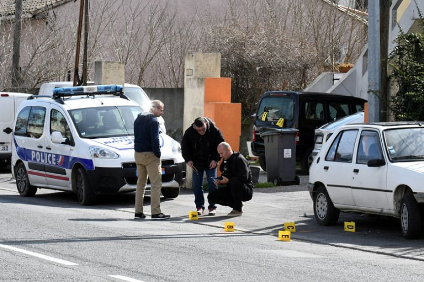 French police secure evidence during an operation underway near Trebes, France, on March 23, 2018.