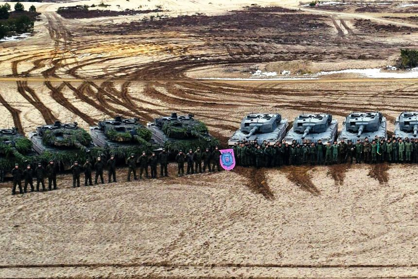 The Singapore Armed Forces' Leopard 2SG Main Battle Tanks (MBTs) (right) and the German Army's Leopard 2A6 MBTs participating in a bilateral training as part of Exercise Panzer Strike.