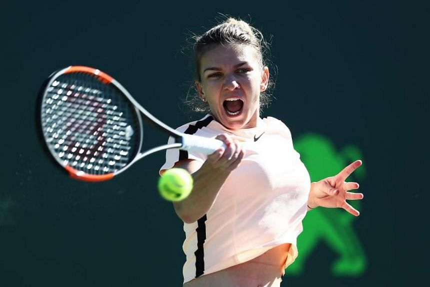 Simona Halep of Romania plays a shot against Oceane Dodin of France during Day 4 of the Miami Open at the Crandon Park Tennis Center on March 22, 2018 in Key Biscayne, Florida.