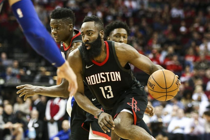 James Harden dribbles the ball during the second quarter against the Detroit Pistons on March 22, 2018.