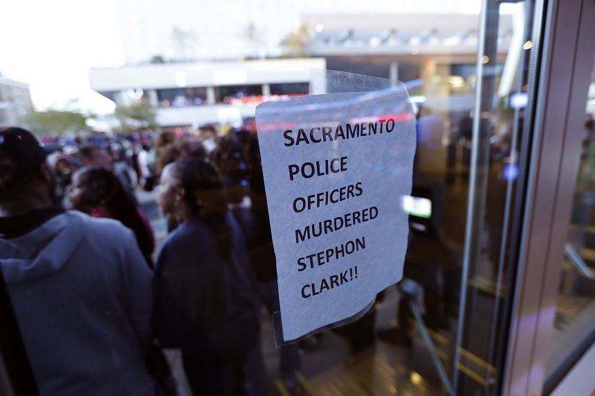 Protesters block the entrance to the Golden 1 Center, preventing patrons from entering the scheduled NBA game between the visiting Atlanta Hawks and Sacramento Kings in Sacramento, on March 22, 2018.