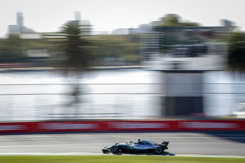 After lapping Albert Park in 1min 24.026sec to dominate the first practice of the new season, Formula One champion Lewis Hamilton improved the mark slightly to 1:23.931 in the second session on a balmy autumn day.