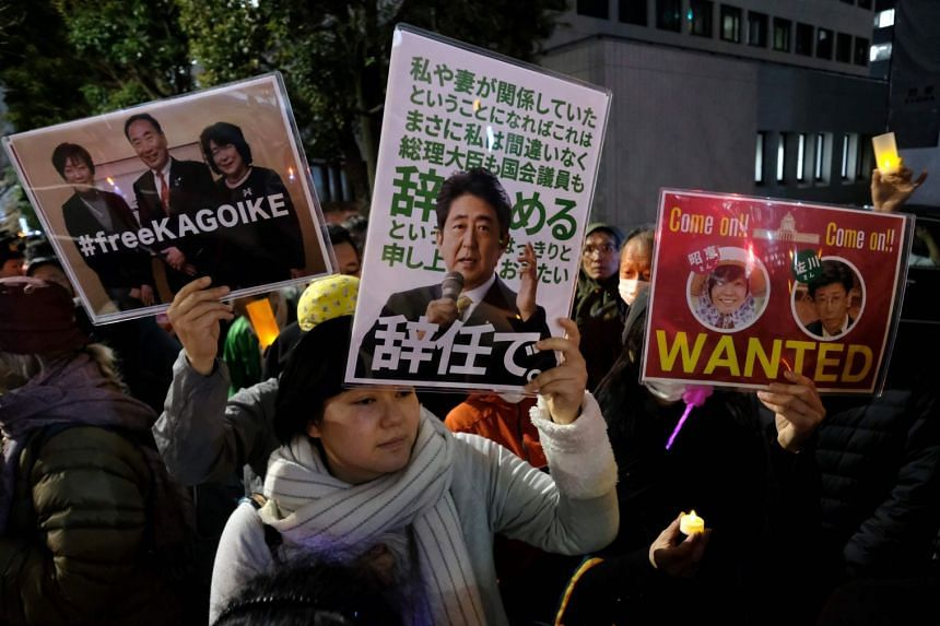 Protesters stage a demonstration near the prime minister's official residence in Tokyo on March 23, 2018.