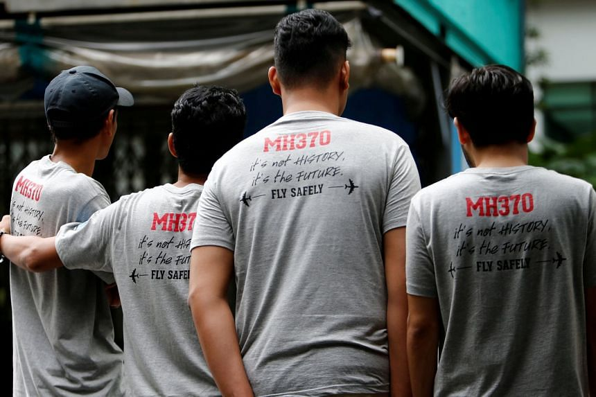 People attending the fourth annual remembrance event for the missing Malaysia Airlines flight MH370 in Kuala Lumpur on March 3, 2018.