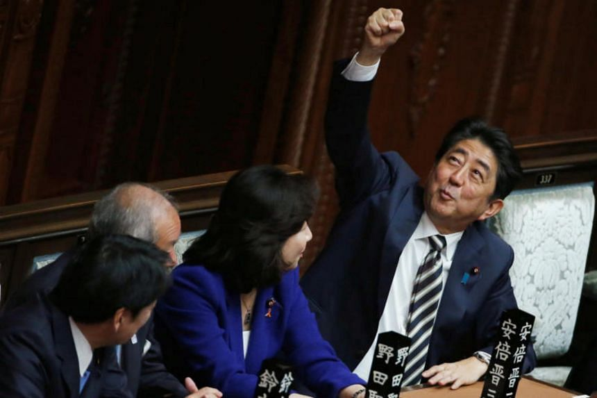 Japan's Prime Minister Shinzo Abe gestures as he talks with ruling Liberal Democratic Party lawmakers at the Lower House of the Parliament in Tokyo on Nov 1, 2017.