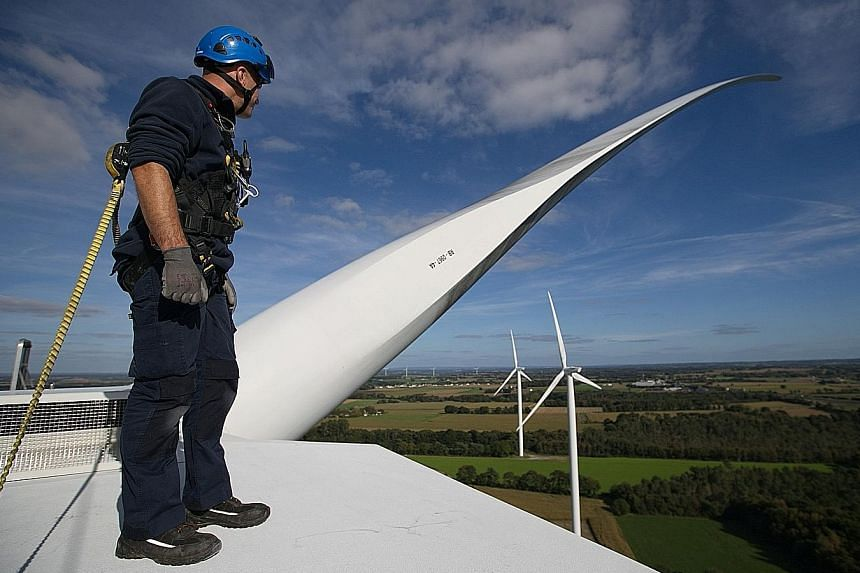 An Engie technician inspecting a wind turbine at its wind farm in Radenac in Brittany, France. The firm is increasingly targeting contracts where it makes more money if it meets energy reduction goals. It is focusing on air cooling and heating, lighting a