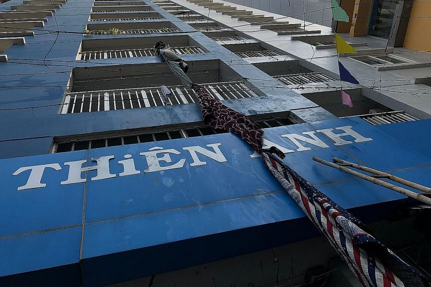 Some residents trapped in the burning building in Ho Chi Minh City tried to escape by tying sheets together and fashioning a rope. An official said many of the victims died of suffocation as they tried to flee the fire by running to the higher floors