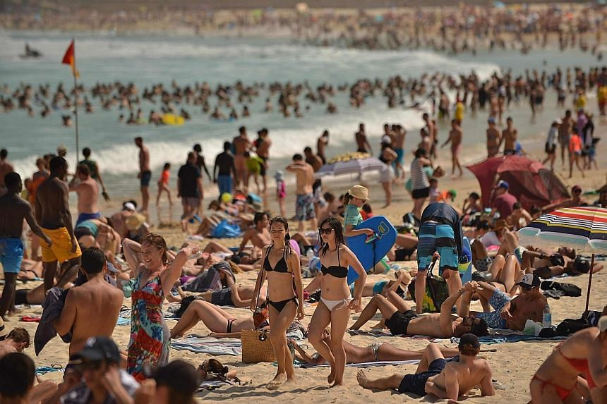 People enjoying the hot weather at Bondi Beach in Sydney. Out of Australia's population of about 25 million people, about five million live in Sydney and 4.7 million in Melbourne.