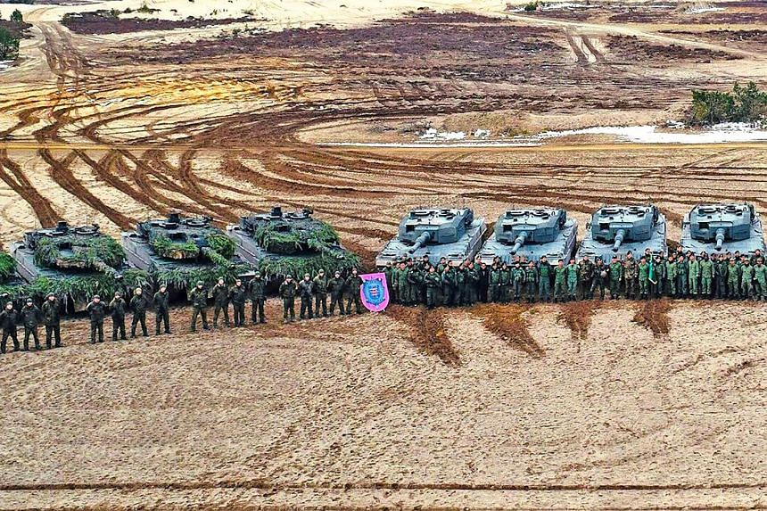 The Singapore Armed Forces' Leopard 2SG Main Battle Tanks (MBTs) (right) and the German Army's Leopard 2A6 MBTs (left) in bilateral training as part of Exercise Panzer Strike.