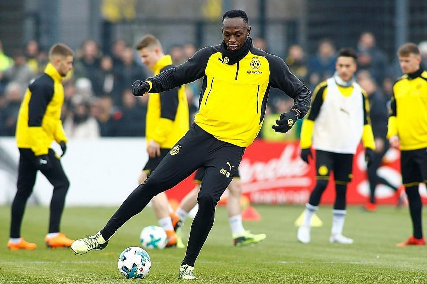 Usain Bolt during his first training session with Borussia Dortmund yesterday. He scored with a header and nutmegged one opponent by knocking the ball between his legs.