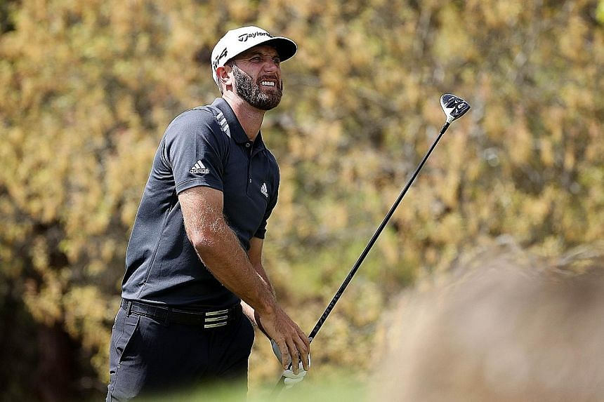 American world No. 1 Dustin Johnson watching his tee shot at the fifth hole in his second group match at the WGC Matchplay on Thursday. The defending champion enjoyed his only birdie of the round here and was knocked out of the event after losing 4 a