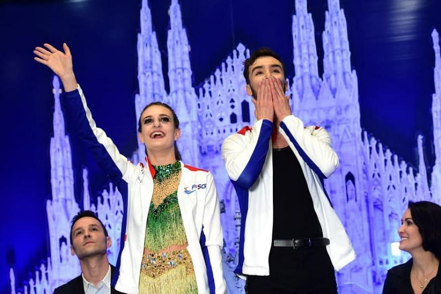 France's Gabriella Papadakis and Guillaume Cizeron gesture during the Ice Dance Short Dance programme at the Milano World Figure Skating Championship 2018 in Milan on March 23, 2018.