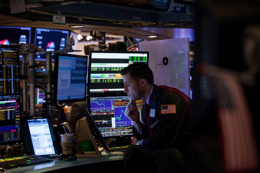 A trader works on the floor of the New York Stock Exchange in New York, US on March 23, 2018.