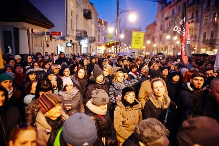 People gather to protest against plans to further restrict abortion laws, in Lodz, Poland on March 23, 2018.