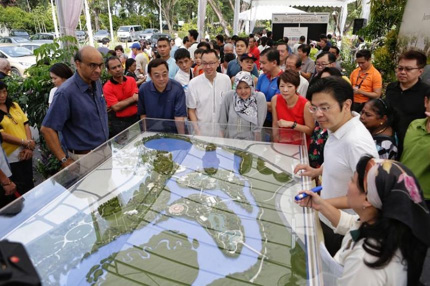 National Development Minister Lawrence Wong, who is also chairman of the Jurong Lake District steering committee, Deputy Prime Minister Tharman Shanmugaratnam and MPs touring the exhibition at Jurong Lake Gardens West on March 24, 2018.